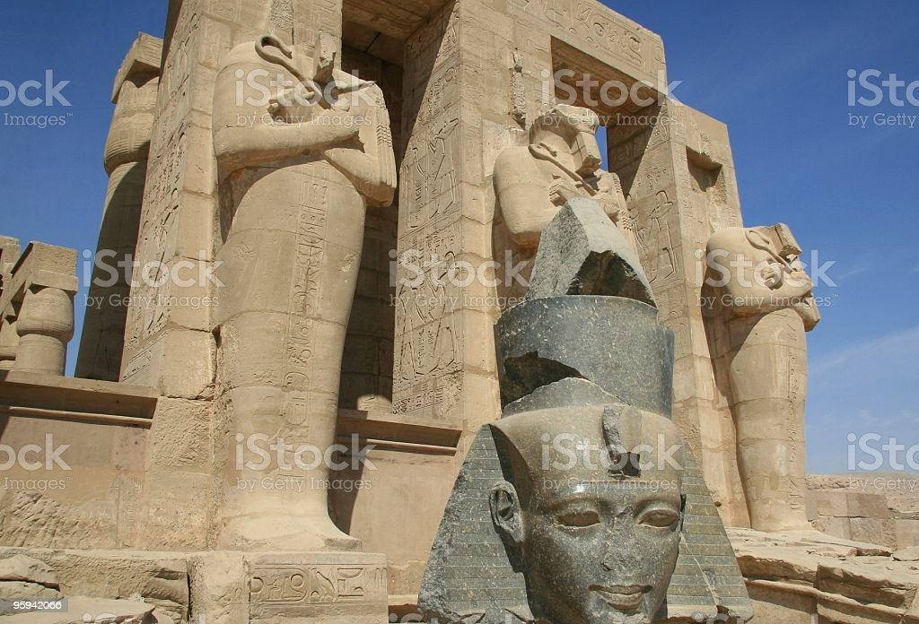 Osiride Pillars and Head of Ramses II, Ramesseum, Thebes, Egypt royalty-free stock photo
