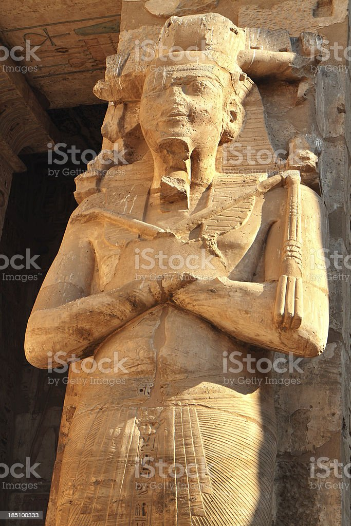 Osiride Statue of Ramesses III, Medinet Habu, Luxor, Egypt. stock photo