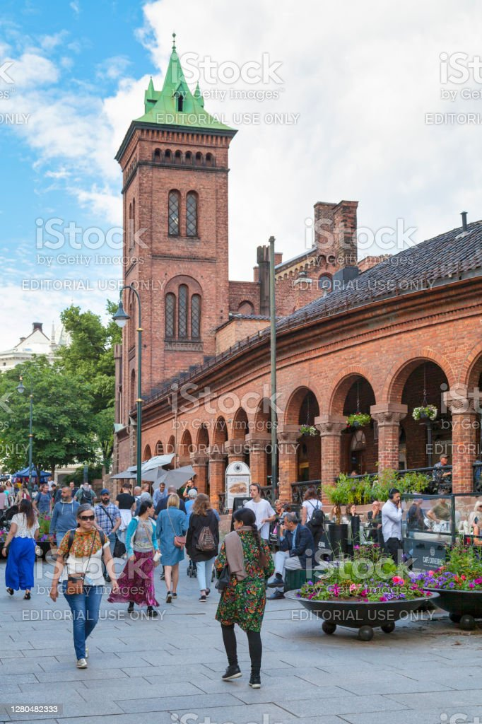 Oslo Bazaars Oslo, Norway - June 26 2019: The Oslo Bazaars (Basarene Kirkeristen) is located along the streets Karl Johans gate and Dronningens gate. The buildings of the bazaar constitute a continuous facility that encircles three sides of the quarter with Oslo Cathedral. Ancient Stock Photo