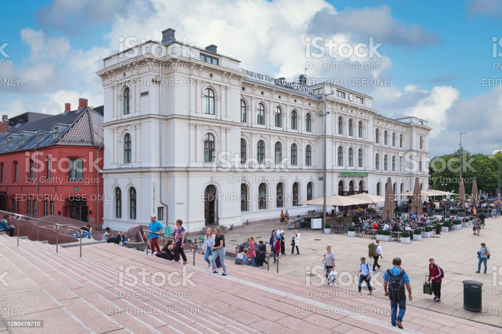 Oslo Central Station Oslo, Norway - June 26 2019: Oslo Central Station (Norwegian: Oslo sentralstasjon, abbreviated Oslo S) is the main railway station in Oslo, and the largest railway station within the entire Norwegian railway system. Architecture Stock Photo