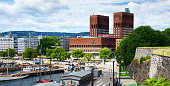 Tourists and locals around the Oslo City Hall in summer time, Norway