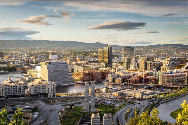 Oslo City in Sunset Light Norway View from above Ekebergparken over Sorenga District towards Oslo Cityscape with Oslo Harbor in late afternoon light close to twilight. Oslo City, Norway, Scandinavia, Europe oslo stock pictures, royalty-free photos & images