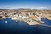 Oslo Cityscape Aerial View of Harbor Waterfront with Opera House, Office Buildings and Promenade on a sunny day. Drone point of view to the cityscape horizon. Oslo, Norway, Scandinavia