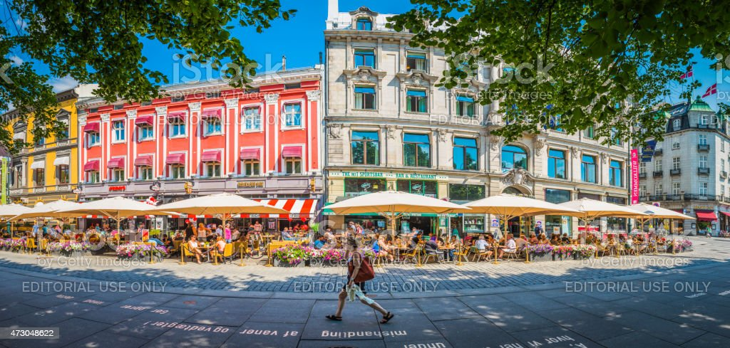 Oslo crowds at pavement cafes vibrant summer city panorama Norway stock photo