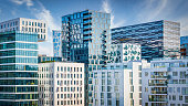 Panorama of Modern Urban Cityscape of Downtown Oslo, the capital city of Norway. Modern Architecture Business Buildings and Skyscapers under blue summer sky. Oslo City Center, Norway, Scandinavia