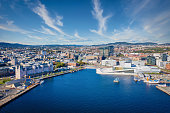 Aerial Drone View over Oslo Harbor Cityscape and Harbor Waterfront under a beautiful summer Sky. Oslo, Norway, Scandinavia