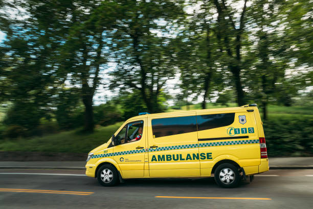 Oslo, Norway. Moving With Siren Emergency Ambulance Reanimation Mercedes Benz Van Car On Street stock photo