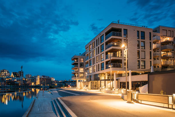 Oslo, Norway. Night View Embankment And Residential Multi-storey House On Sorengkaia Street In Gamle Oslo District. Residential Area In Summer Evening stock photo