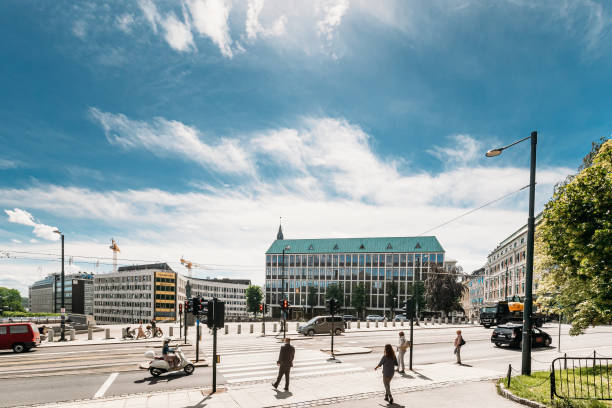 Oslo, Norway. People Cross The Road On The Henrik Ibsens gate Street. stock photo