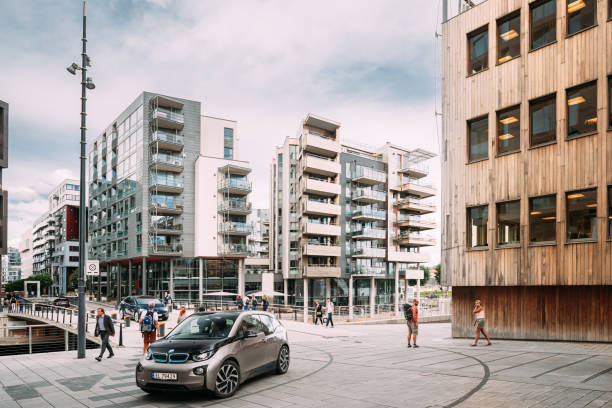 Oslo, Norway. People Walking Near Residential Multi-storey Houses In Aker Brygge District In Summer Evening. Famous And Popular Place. stock photo