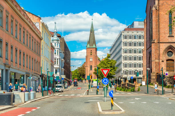 Oslo, Norway: View of St. Olav's Cathedral in the center of Oslo. A street with historical architecture and walking people stock photo