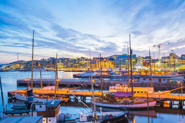 Oslo port with boats and yachts at twilight in Norway Oslo city, Oslo port with boats and yachts at twilight in Norway. oslo stock pictures, royalty-free photos & images