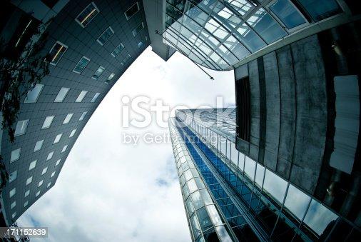 istock oslo skyscraper reflecting in facade, fish-eye lens. 171152639