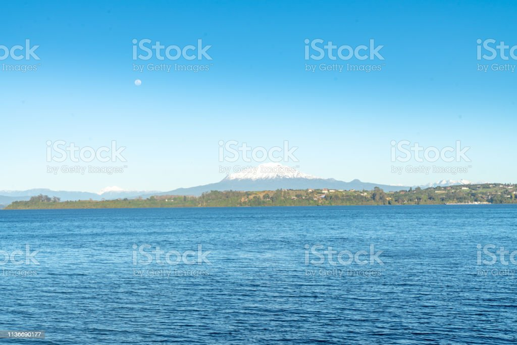 Osorno Volcano and Volcán Calbuco with moon - Chilean Lake District, Puerto Varas,Chile stock photo