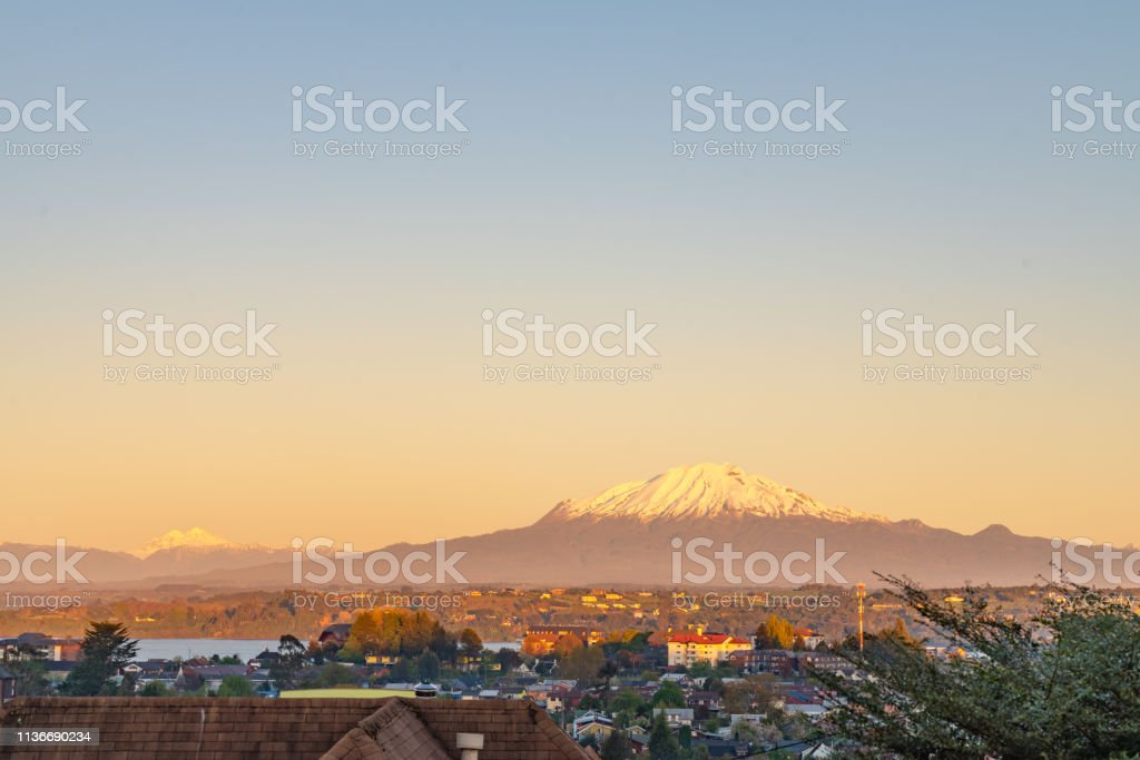 Osorno Volcano, Volcán Calbuco at dusk  in Chilean Lake District - Puerto Varas, Chile stock photo