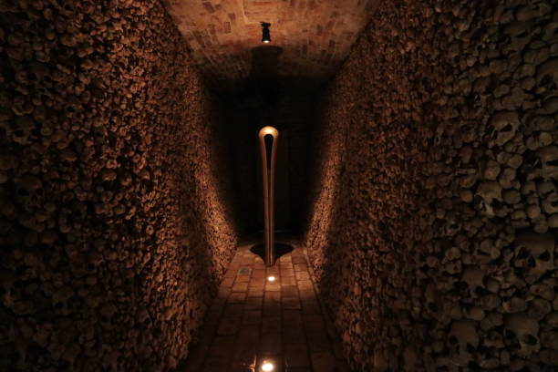 Ossuary at the Church of St James (Kostnice u sv. Jakuba) Brno, Czech Republic, December 31, 2017: skulls in the Ossuary of St James Church on Jakubske square in Brno.The number of people buried here is estimated to exceed 50,000. After Paris, Brno have the second-largest ossuary in Europe.  The Ossuary at the Church of St James is an attraction for tourists. The tour is very impressive also becouse of the music composed especially for this place. brno stock pictures, royalty-free photos & images