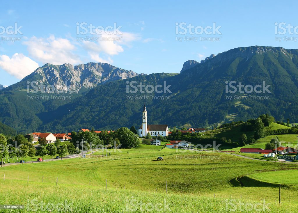 Ost-Allgäu, Pfronten with church St. Nikolaus, view of the Breitenberg and Brentenjoch, Bavaria, Germany stock photo