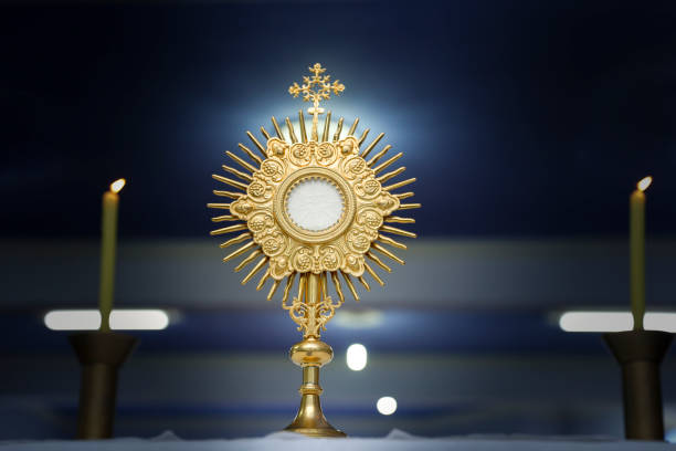 Ostensorial adoration in the catholic church stock photo