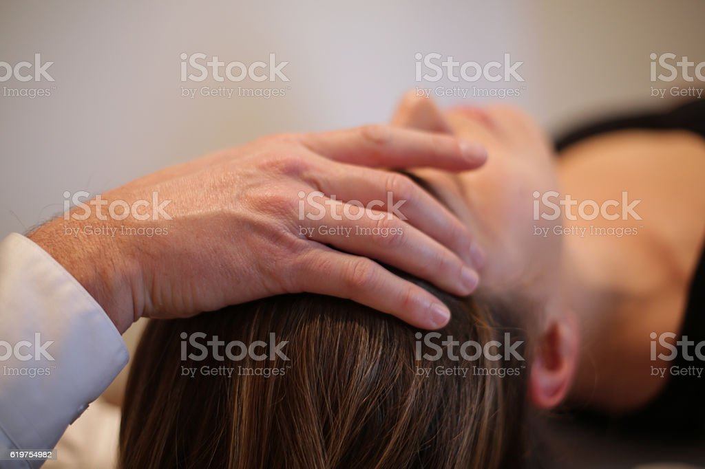 Osteopath manipulating a patient stock photo