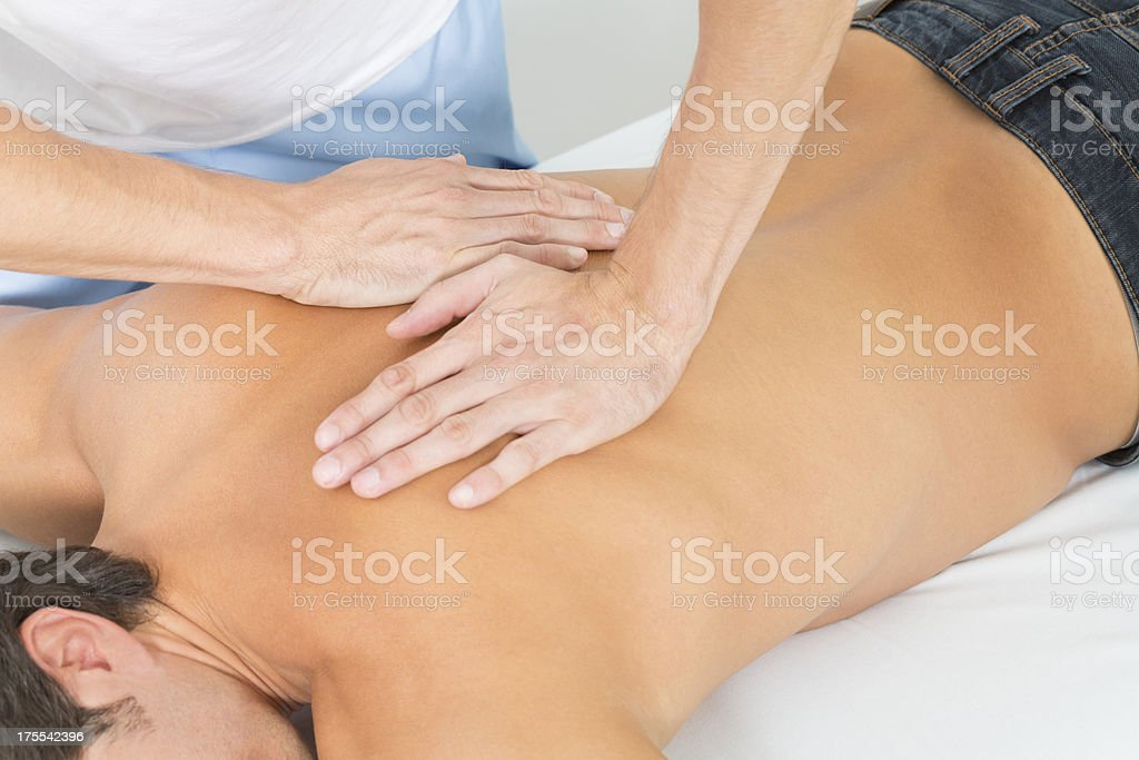 osteopath treating male patient stock photo