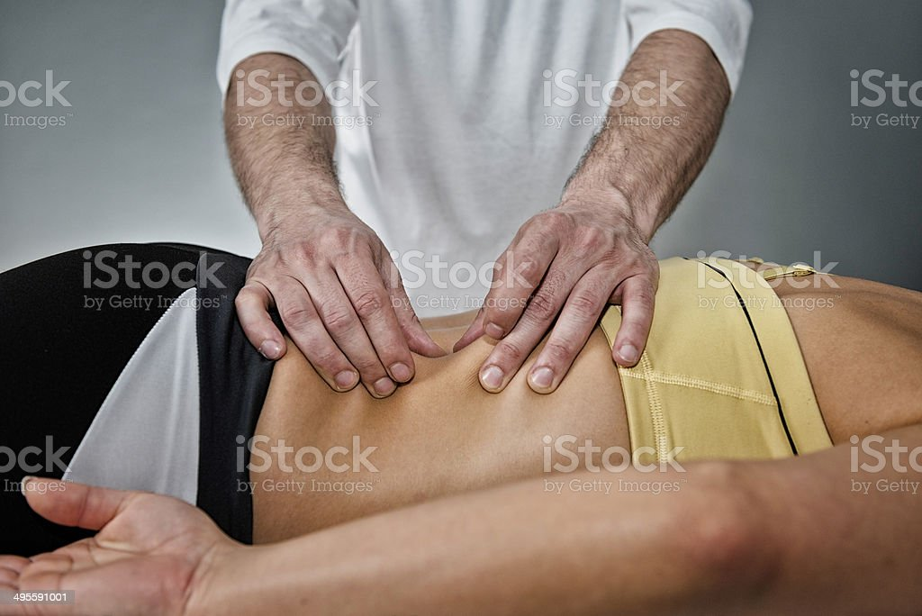 Osteopath working with patient stock photo