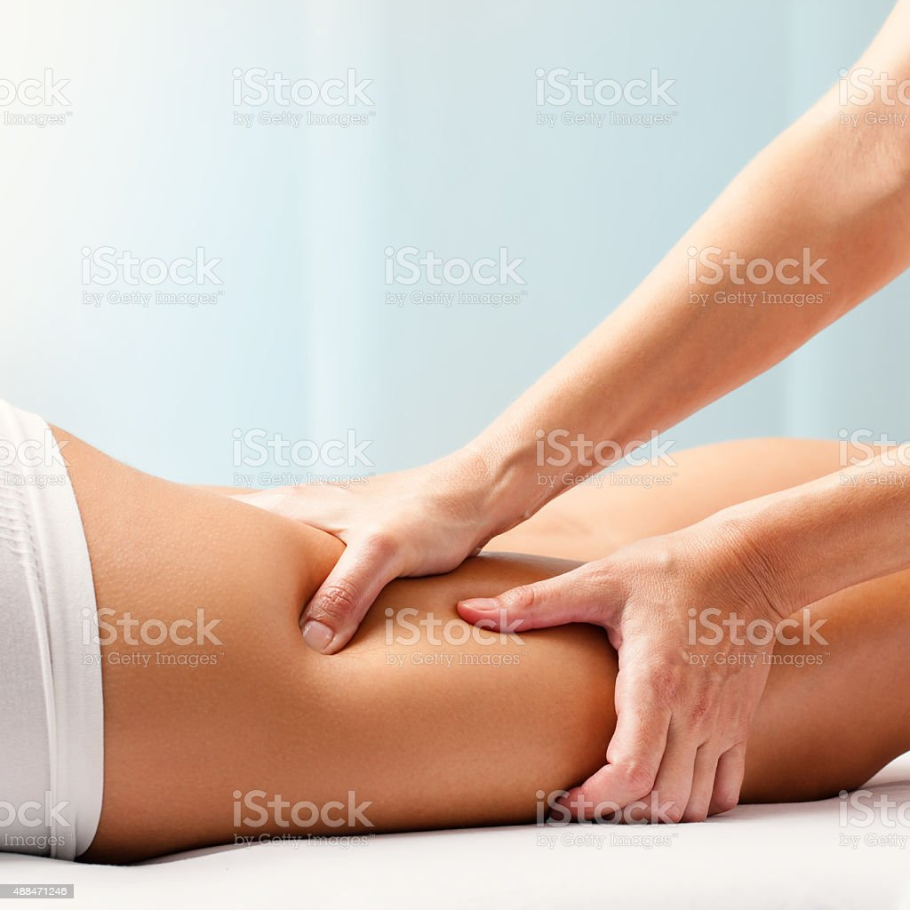 Osteopathic hamstring massage. stock photo