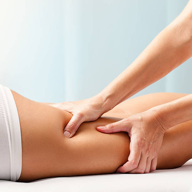 Osteopathic hamstring massage. stock photo