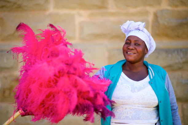 Ostrich Feather Seller looking at camera smiling stock photo