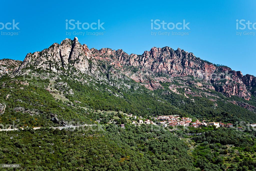 Ota village dominated by Capu Ota Mountain stock photo