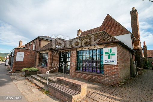 Otford Pharmacy in Kent, England. This is a privately owned business. A cafe is in the background.