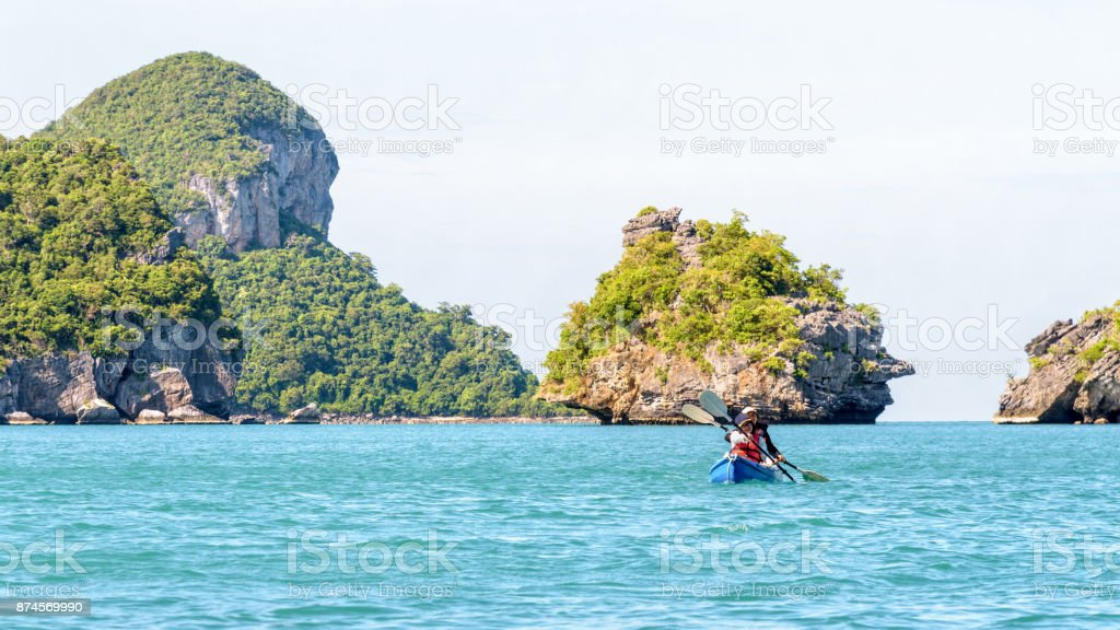 other and daughter travel by kayak stock photo