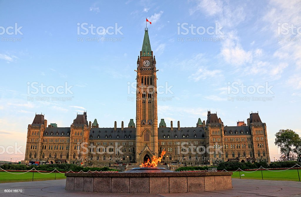 Ottawa Parliament Building and Cennential Flame stock photo
