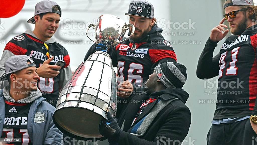 Ottawa Redblacks with Grey Cup during parade stock photo
