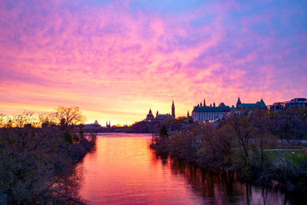 Ottawa River and Ottawa Parliament Hill at Sunrise, Canada stock photo
