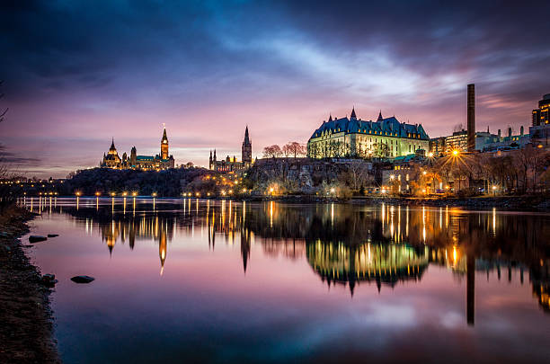 ottawa river and parliament of canada at sunrise - canada parliament stock photos and pictures