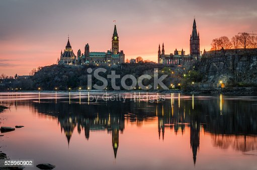 Ottawa at sunrise overlook the Parliament of Canada and the Supreme Court of Canada on a brisk fall day.