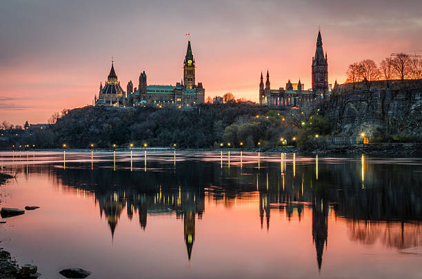 ottawa river at sunrise - canada parliament stock photos and pictures