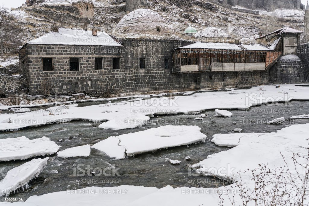 Ottoman bath by frosted river in Kars, Turkey stock photo