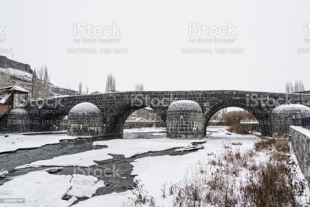 Ottoman bridge on frosted river in Kars city in Turkey stock photo