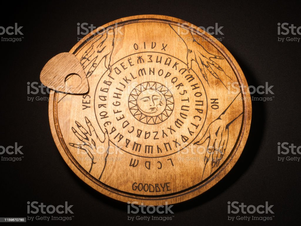 Ouija Board Yellow On A Black Background Stock Photo