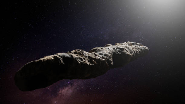 Oumuamua comet, interstellar object passing through the Solar System, unusual shaped asteroid asteroid in deep space lit by a star apparently stock pictures, royalty-free photos & images