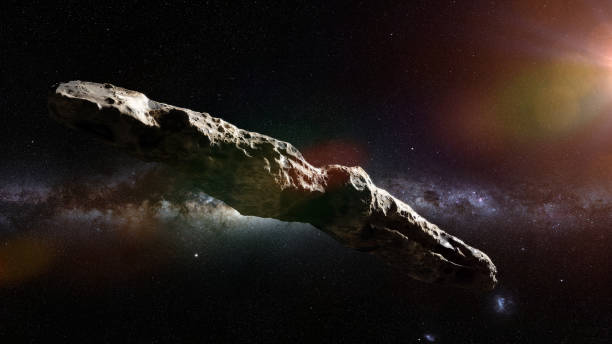 Oumuamua is an active comet, interstellar object  passing through the Solar System, unusual shaped asteroid asteroid in deep space lit by a star apparently stock pictures, royalty-free photos & images