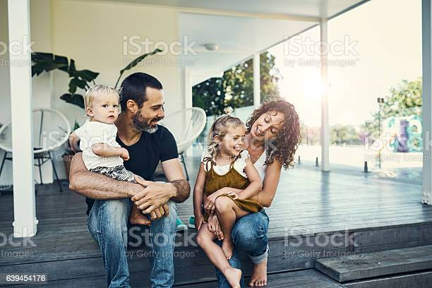 Shot of a happy young family spending the weekend together at home