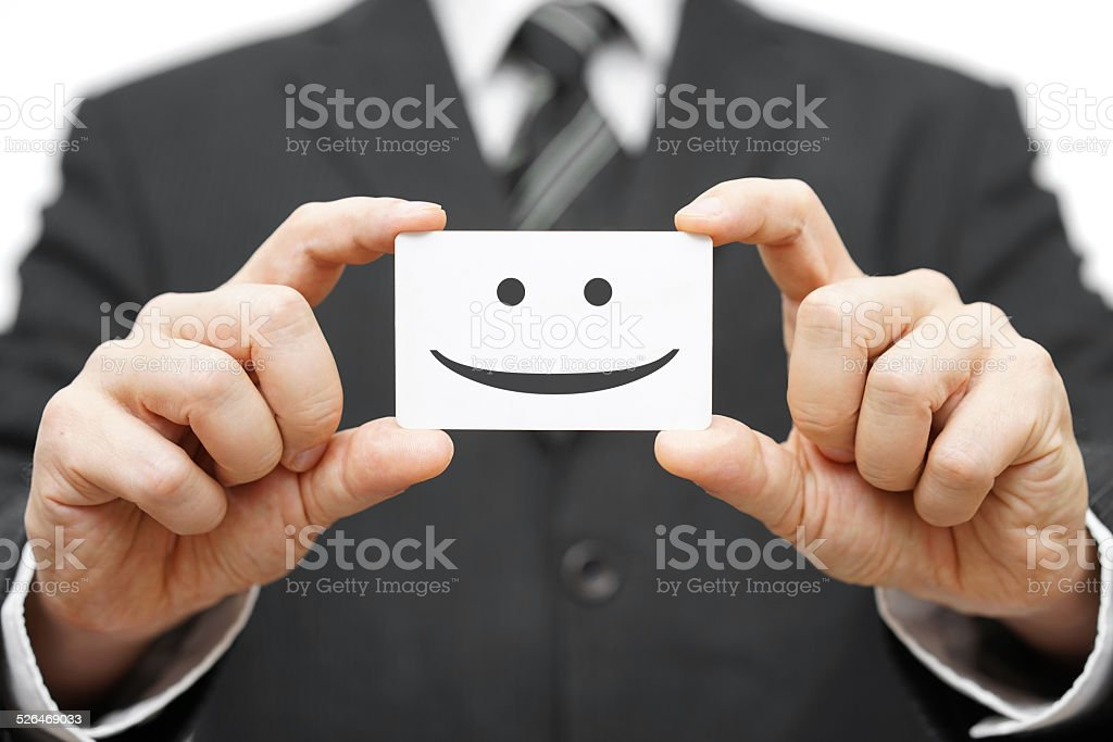 our clients are happy clients, smile on business card stock photo