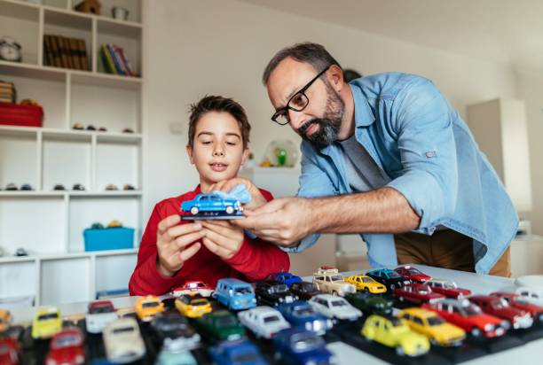 Our collection toy Photo of father and son with his car collection collection stock pictures, royalty-free photos & images