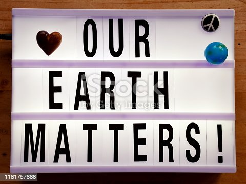 Words 'Our Earth Matters' in a Light Box Trend for a Climate Change Theme.