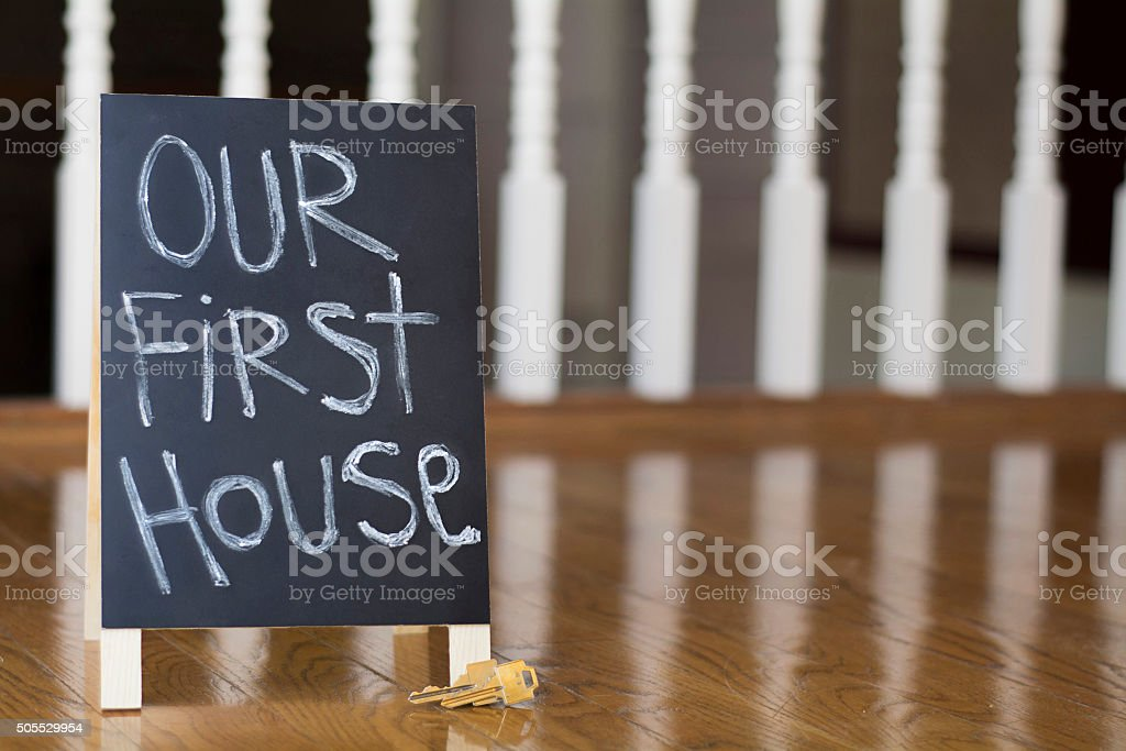 Our first house sign with keys stock photo