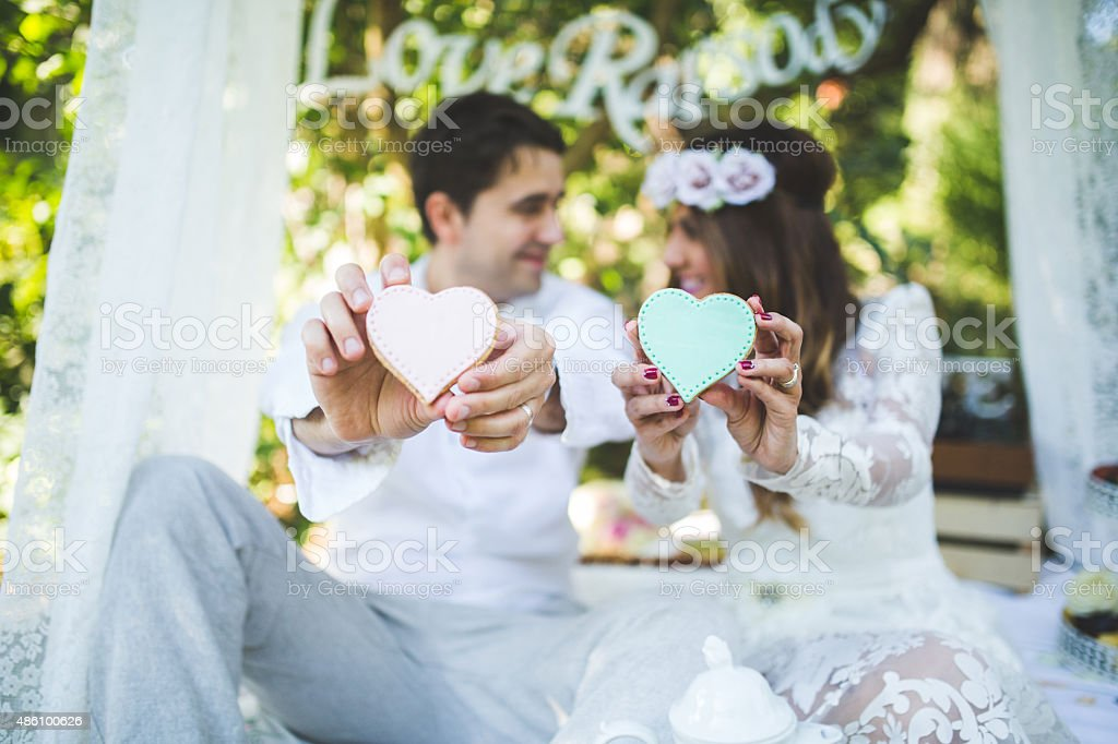 Our hearts! Newlyweds in romantic bed 2015 Stock Photo