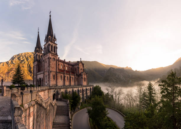 Our Lady of Covadonga, surrounded by fog at sunrise, Asturias province, northwestern Spain stock photo