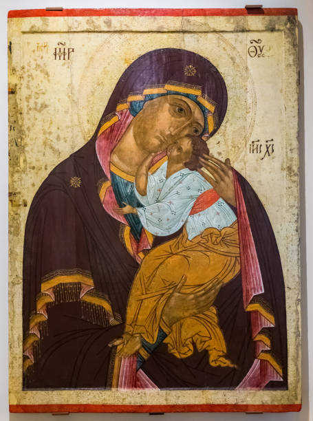 Our Lady of Tenderness, painted on old wooden board, 1460s stock photo